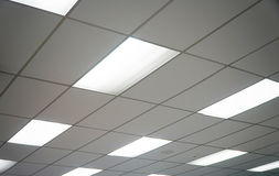 White ceiling with neon light bulbs in uprisen view Royalty Free Stock Images