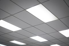 White ceiling with neon light bulbs in uprisen view Stock Photos
