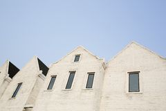 White cement brick block wall with a narrow window Royalty Free Stock Images