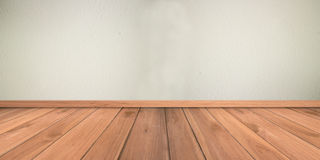 White cement plaster wall and wood floor Royalty Free Stock Photography