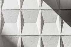 White cement wall with geometric shapes as background Royalty Free Stock Images