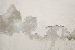 White cement wall with peeling paint. royalty free stock photo