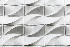White cement wall with wavy shapes as background. White cement wall with wavy shapes as abstract background in Berlin, Germany Royalty Free Stock Photo
