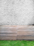 White Cement Wall, Wooden Floor and grass Stock Photos
