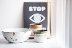White Ceramic Bowl Beside Beige Ceramic Cup Stock Images