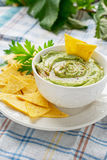 White ceramic bowl filled with avocado dip Royalty Free Stock Photography