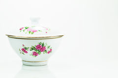 White ceramic bowl with red rose flowers on white background Stock Photography