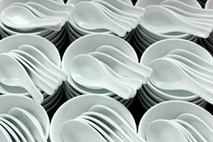 white ceramic bowls and spoons Royalty Free Stock Image