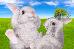 White ceramic bunnies on natural background Stock Photography