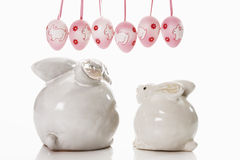 White ceramic bunny with pendant easter eggs Stock Images