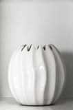 White ceramic clay pot for decoration on shelf Royalty Free Stock Image