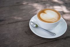 White Ceramic Coffee Cup With White Ceramic Saucer royalty free stock photography