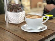 White Ceramic Coffee Mug With Saucer and Teaspoon royalty free stock image
