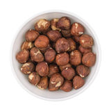 White ceramic cup bowl filled with the multiple hazelnuts Stock Photo