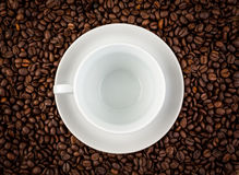 White ceramic cup on coffee Royalty Free Stock Photo