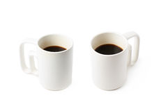 White ceramic cup of coffee isolated. Over the white background, set of two different foreshortenings Royalty Free Stock Photo