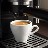 White ceramic cup of fresh espresso with foam Royalty Free Stock Photos