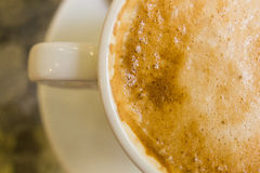 White ceramic cup with hot coffee close up. Blurred Royalty Free Stock Image