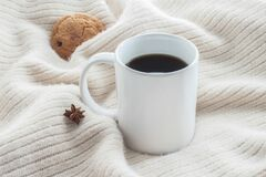 Free White Ceramic Cup Of Coffee Without Cream With Cosy Blanket, Cookie And Star Anice Stock Photography - 195803622
