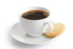 White ceramic cup and saucer with black coffee and shortbread bi. Scuit. Isolated Stock Photo