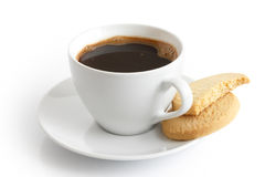 White ceramic cup and saucer with black coffee and shortbread bi Royalty Free Stock Photo