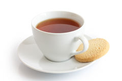 White ceramic cup and saucer with rooibos tea and shortbread bis Stock Photos