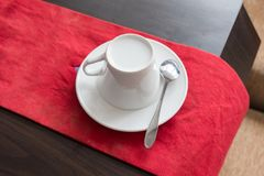 White ceramic cup set prepare on red cloth and table. White ceramic cup set prepare on red cloth and wood table Royalty Free Stock Photography