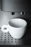 White ceramic cup stands in automatic coffee machine Stock Images