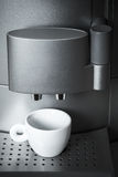 White ceramic cup stands in coffee machine Stock Photography