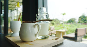 White ceramic cup on timber block Stock Images