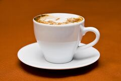 White Ceramic Cup on White Ceramic Saucer Royalty Free Stock Image