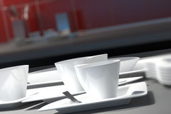 White ceramic cups and saucers Royalty Free Stock Photos