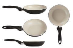White ceramic frying pan isolated on white background Stock Photos