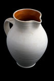 White ceramic jug. White jug on black background Stock Photo