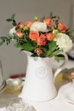 White ceramic jug full of flowers Royalty Free Stock Image