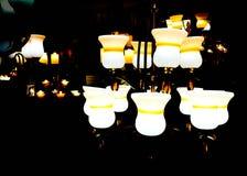 White ceramic lamp glowing in the dark. Royalty Free Stock Photos