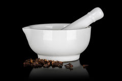 White ceramic mortar with clove Stock Image