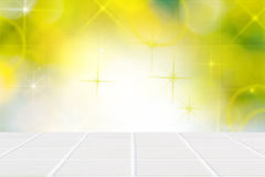 White ceramic mosaic floor and lights on green wall Royalty Free Stock Image