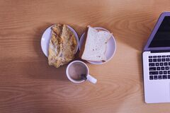 White Ceramic Mug Beside Bread on White Ceramic Saucer Royalty Free Stock Photo