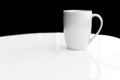 White ceramic mug empty blank for coffee or tea Royalty Free Stock Images