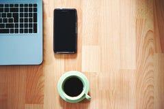 White Ceramic Mug Near Black Smartphone Stock Photography