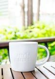 White ceramic mug with stamp word Royalty Free Stock Image