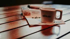 White Ceramic Mug on Table Royalty Free Stock Photos
