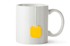 White ceramic mug with teabag label Royalty Free Stock Image