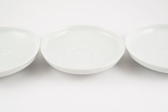 White ceramic plate composition background Royalty Free Stock Images
