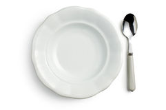 White ceramic plate with spoon Stock Photography