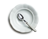 White ceramic plate with spoon Royalty Free Stock Photo