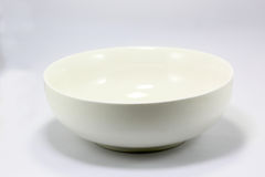 White ceramic porcelain bowl. On white background Stock Images