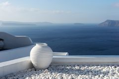 White ceramic pottery on the terrace in Oia town on Santorini Royalty Free Stock Images