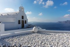 White ceramic pottery on the terrace in Oia town on Santorini Stock Photography